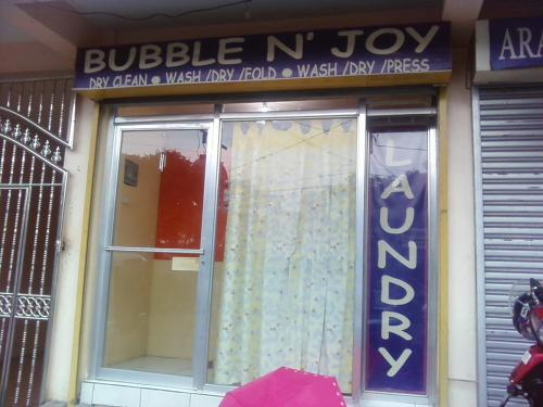 Your Clothes is Our Business - Bubble n' Joy Laundry Shop - a quick peek into the shop facade